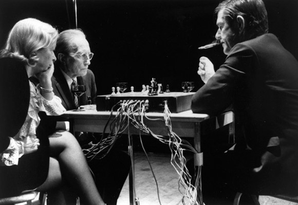 John Cage, Marcel Duchamp, & Teeny Duchamp performing Reunion at its premiere in Toronto, 5th March, 1968. Photograph by Lynn Rosenthal, courtesy of The John Cage Trust.